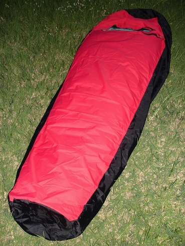 Long enough - The Bivy Sack is over 7 feet long with round panels at the head and foot. There is plenty of space, so you won't feel constricted.