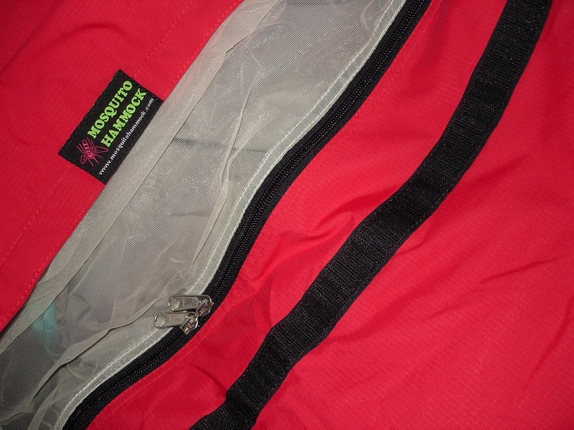 Opening of Bivy Sack - showing double zip mosquito netting and velcro closure for rain hood.